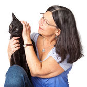 Woman Petting Black Cat — Stock Photo