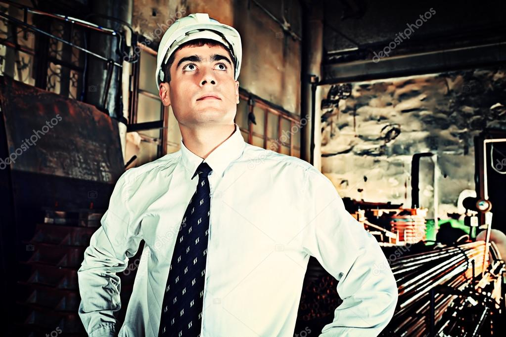 Industrial theme: businessman at a manufacturing area. — Stock Photo #12482580