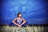 Sitting in grass — Stock Photo