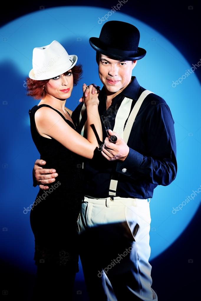 Couple of professional singers in retro style posing in costumes at studio. — Stock Photo #12600745