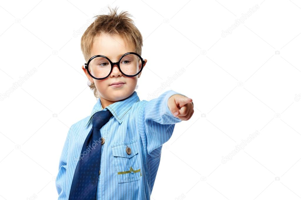 Little boy in spectacles and suit pointing the finger at something. Isolated over white background. — Stock Photo #12600756