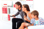 Happy family emotionally watching television at home. — Stock Photo