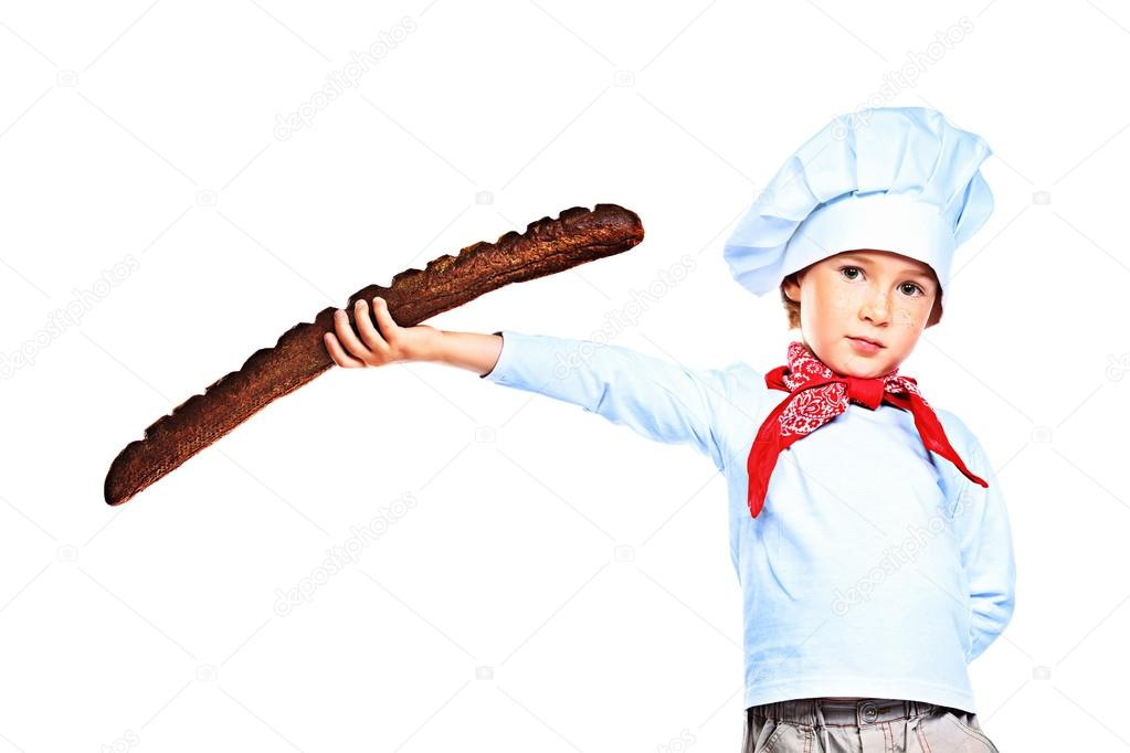 Portrait of a little kitchen boy holding french bread. Isolated over white background. — Stock Photo #12882675