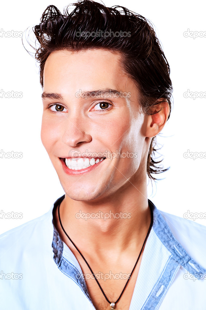 Portrait of a smiling young man. Isolated over white background. — Stock Photo #12882678