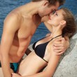 Kiss on a beach - Stock Photo