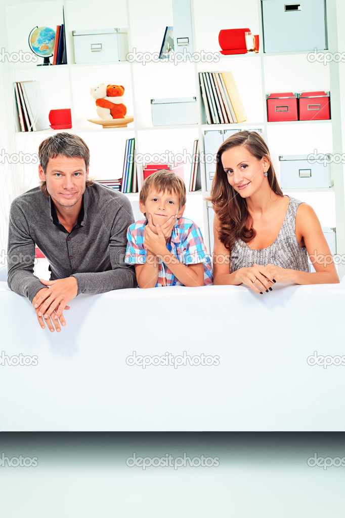 Happy parents with their son together at home.  Stock Photo #13302461