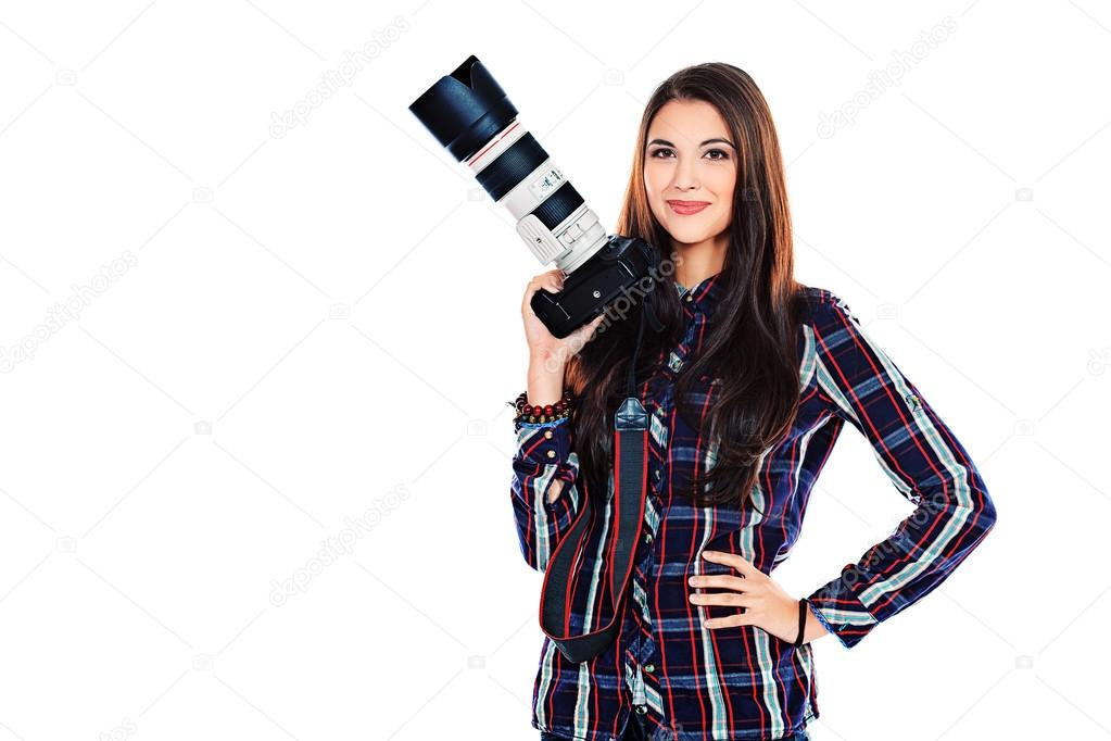 Pretty young woman taking pictures on the camera. Isolated over white. — Stock fotografie #14173764