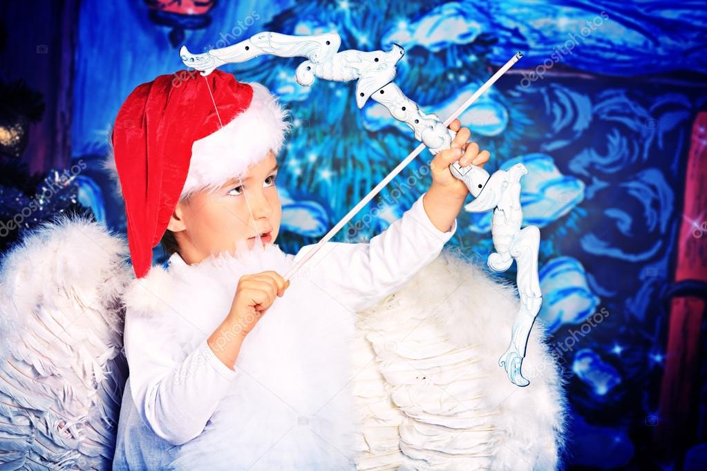 Beautiful little angel boy over Christmas background. — Stock Photo #14502707
