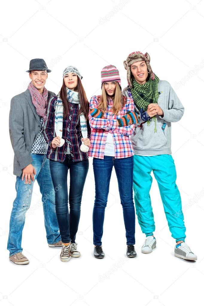 Group of young in autumn clothes standing together. Friendship. Isolated over white. — Photo #16345039