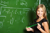 Portrait of a smiling schoolgirl in a classroom. — Stock Photo