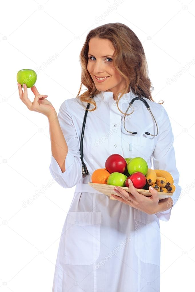 Portrait of a smiling woman doctor holding fresh fruits. Isolated over white background. — Stock Photo #18819403