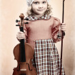 Portrait of a pretty little girl posing with her violin. Vintage style. — Stock Photo #19593691