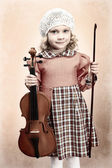 Portrait of a pretty little girl posing with her violin. Vintage style. — Stock Photo