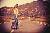 Walking with suitcase — Stock Photo
