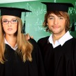 Students in gowns — Stock Photo