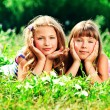 Stock Photo: Girls on grass