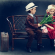 Cute little boy is giving bouquet of tulips to the charming little lady. Retro style. — Stock Photo #22962202