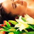 Lying with flowers - Stock Photo
