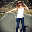 Blonde hitchhiker — Stock Photo #24329075
