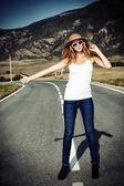 Blonde hitchhiker — Stock Photo