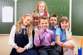 Child in classroom — Stock Photo
