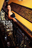 Belle on stairs — Stock Photo