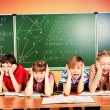 Stock Photo: Tired schoolchildren