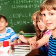 Girl in classroom — Stock Photo