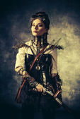 Portrait of a beautiful steampunk woman over grunge background. — Stock Photo