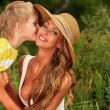 Kissing mom — Stock Photo