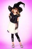 Girl in witch hat — Zdjęcie stockowe