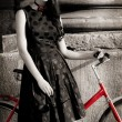 Stock Photo: Lady with bicycle