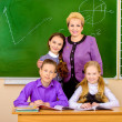 Teacher with students — Stock Photo #39990971