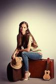 Sitting on suitcases — Stock Photo