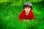 Lie on a grass — Стоковое фото