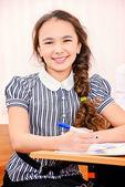 Smiling schoolgirl — Stock Photo