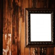 Vintage photo frame on grunge wood wall — Stock Photo