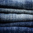 Stack of blue jeans closeup — Stock Photo