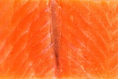 Red fish,close up salmon slice texture — Stock fotografie