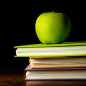 Stack books and green apple — Stock Photo