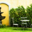 Stock Photo: White chair in the garden