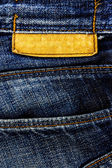 Jeans texture with leather label. — Stock Photo