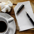 Cup of coffee with notepad, pen and crumpled paper on wooden bac — Foto Stock #35477839