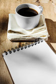 Sketchbook and instant coffee in white cup against wood backgrou — Stock Photo