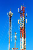 Telecommunication tower against blue sky background — Stock Photo