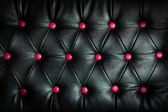 Abstract black Leather against pink dot background — Stock Photo