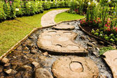 Landscape garden design. The path in the garden with pond in asi — Stock Photo