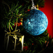Christmas background with baubles and christmas tree  — Stok fotoğraf