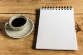 Sketchbook and instant coffeeagainst wood background — Stock Photo