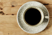 Coffee cup on wood table with copy space. — Foto Stock